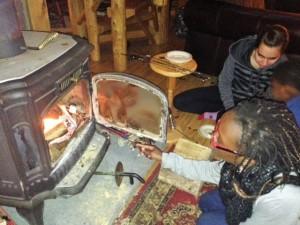 Elmise roasting a marshmellow